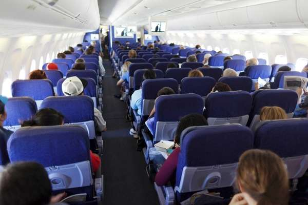 This file photo shows passengers on an airplane.