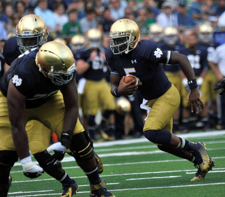 Notre Dame quarterback Everett Golson heads toward the