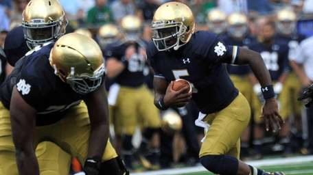 Notre Dame quarterback Everett Golson heads toward the