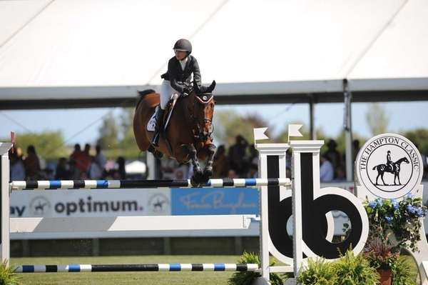 Georgina Bloomberg, riding Washington Square, clears a jump