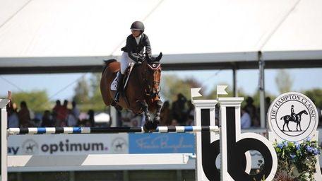 Georgina Bloomberg, riding Washington Square, clears a jump