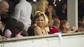 Entertainer Jennifer Lopez and her children attend the