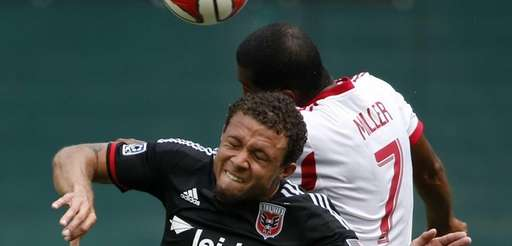 D.C. United midfielder Nick DeLeon (14) and Red