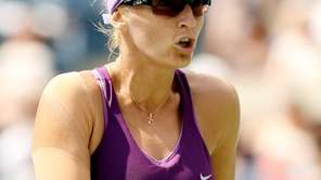 Mirjana Lucic-Baroni of Croatia reacts against Sara Errani