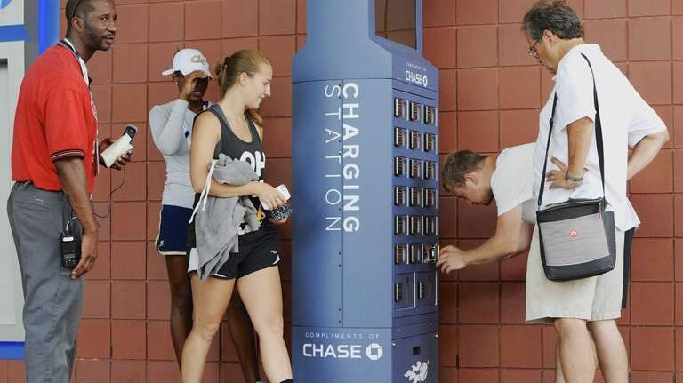 U.S. Open attendees power their cell phones at