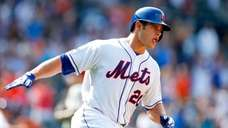 The Mets' Anthony Recker runs the bases after