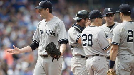 Yankees starting pitcher Brandon McCarthy, left, gestures toward