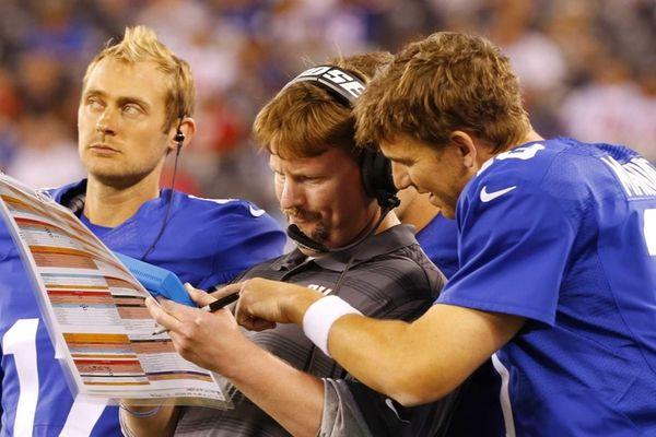 Giants offensive coordinator Ben McAdoo goes over a