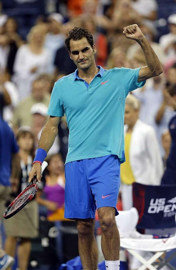 Roger Federer reacts after his four-set victory over