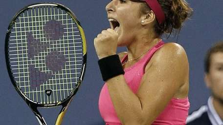 Belinda Bencic reacts after taking the first set