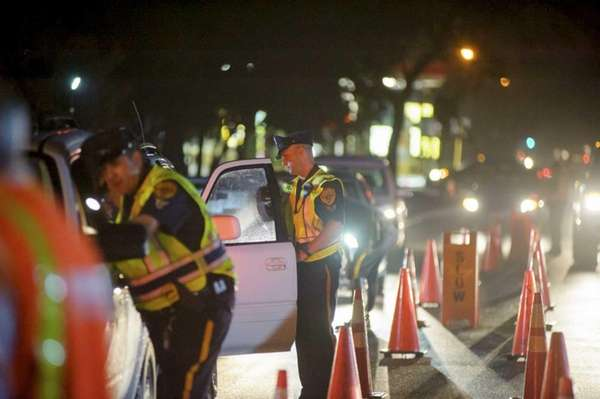 Police at the scene of a sobriety checkpoint