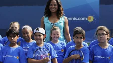 Laila Ali attends a youth tennis exhibition at