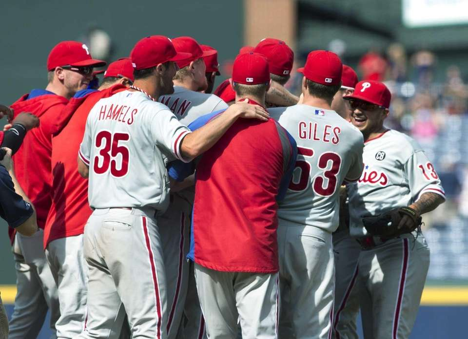 The Philadelphia Phillies celebrate after a combined no-hit