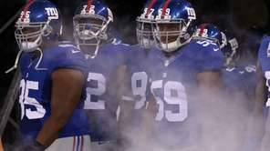 The Giants are introduced before a preseason game