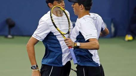 Doubles partners Bob Bryan, left, and Mike Bryan