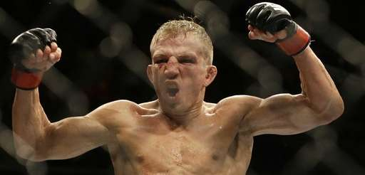 T.J. Dillashaw celebrates after defeating Joe Soto in