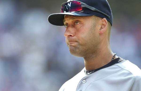 The Yankees' Derek Jeter walks off the field