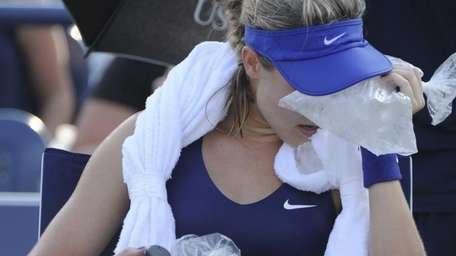 Eugenie Bouchard attempts to cool down with bags