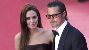 Brad Pitt and Angelina Jolie arrive for the