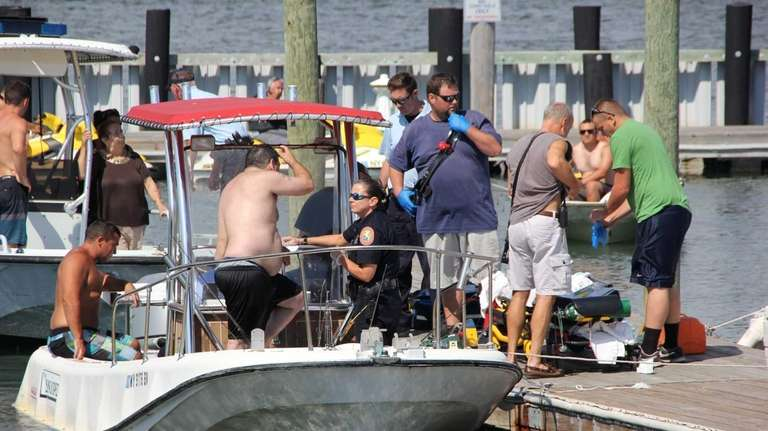 Boaters and emergency personnel at West Marina in