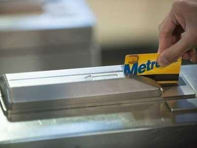 An MTA rider uses a MetroCard to ride