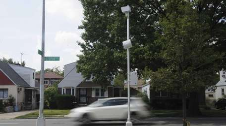 A speed camera clocks vehicles traveling southbound on