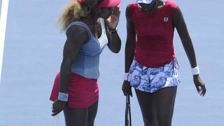 Serena Williams and Venus Williams strategize against Ekaterina