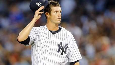 Shane Greene of the Yankees stands on the