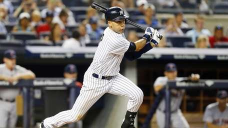Derek Jeter of the Yankees grounds out in