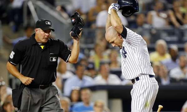 Brett Gardner of the Yankees slams his helmet