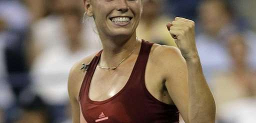 Caroline Wozniacki celebrates after her straight sets victory