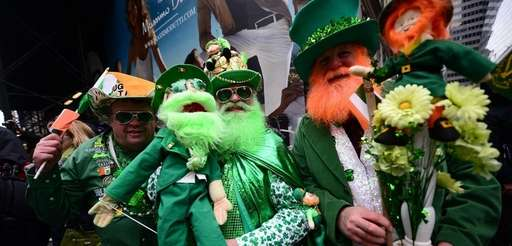 Paradegoers enjoy the St. Patrick's Day Parade on