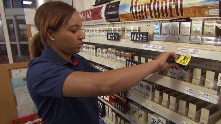 CVS Health employee removes tobacco products from the