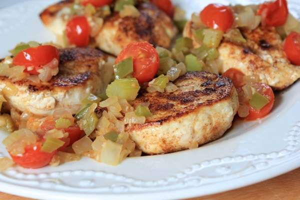 Sauteed chicken breasts are dusted with Cajun seasoning