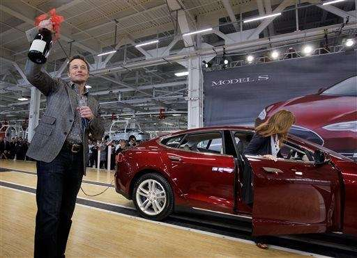 Tesla Motors CEO Elon Musk holds up a