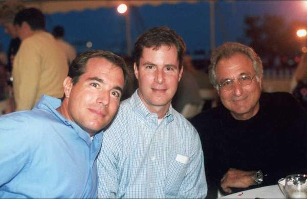 Bernard Madoff, right, is seen in a 2001