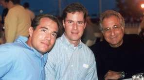 Bernard Madoff, right, is seen in a 2001