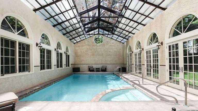 An Indoor Pool With A Retractable Roof Comes