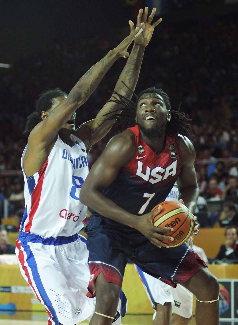 USA forward Kenneth Faried, right, vies with Dominican