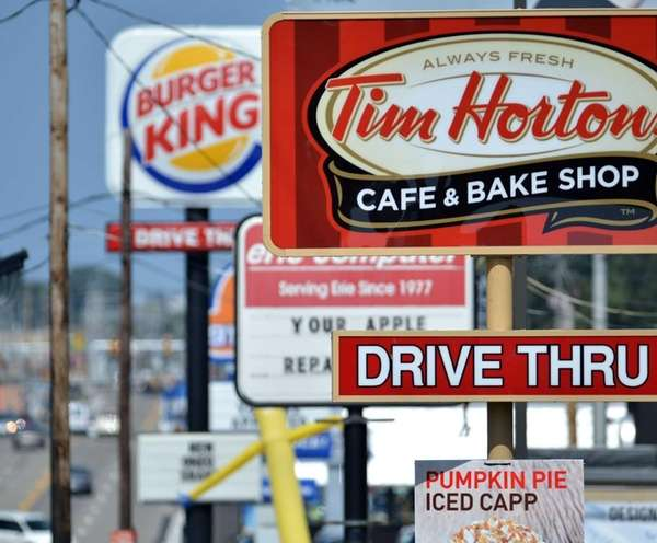 Signs for a Tim Hortons restaurant, foreground, and