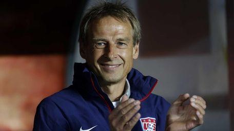 USA head coach Juergen Klinsmann claps as he