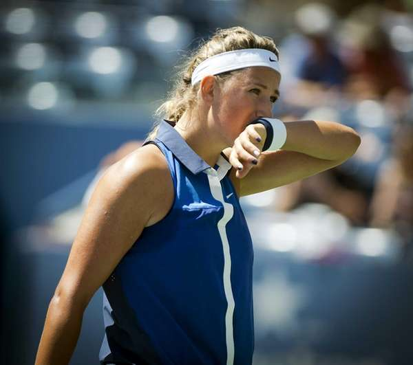 Victoria Azarenka wipes the sweat from her face