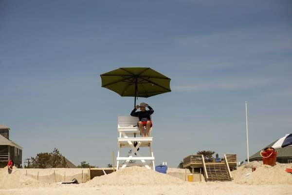 A lifeguard keeps watch over the beach at
