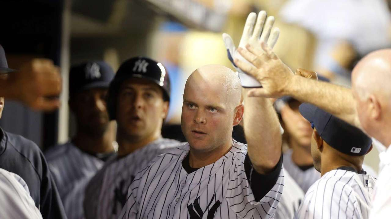 The Yankees' Brian McCann celebrates his second-inning two-run