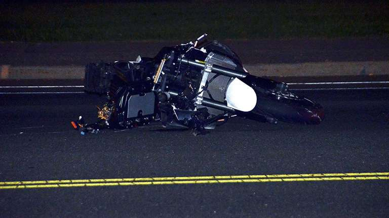 The scene of a accident where a motorcyclist