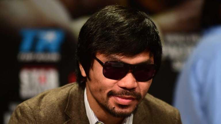 <a href='http://www.newsday.com/sports/boxing/manny-pacquiao-with-eye-on-floyd-mayweather-knows-to-take-chris-algieri-seriously-1.9546510'>Taking it seriously</a>