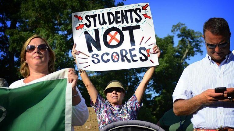 Sally Intreglia, center, a Brentwood teacher, holds a