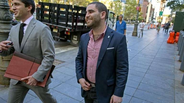 Charles Shrem, center, the top executive of a