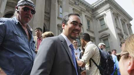 Tim Wu, center, a candidate for New York