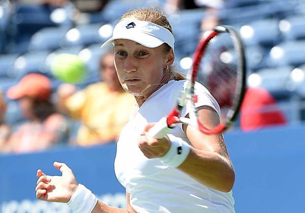 Russia's Ekaterina Makarova hits a forehand against Victoria
